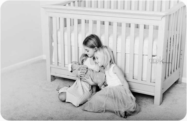 sisters with newborn