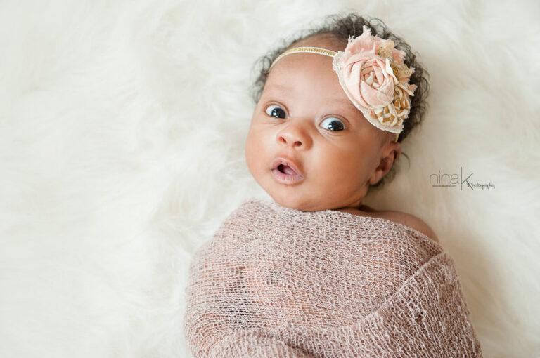 newborn with bright eyes